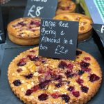 large almond tarts with berries