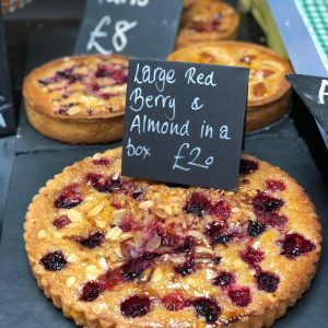 large frangipane (almond) tart with raspberries
